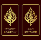 Restroom golden signs Royalty Free Stock Image