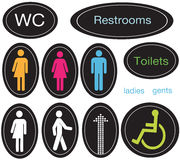 Restroom Icons. A set of restroom signs and icons Royalty Free Stock Images