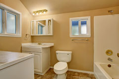Restroom interior with beige walls. Refreshing white vanity cabinet Stock Photos