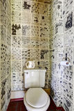 Restroom interior design. News paper all over the wall Royalty Free Stock Images