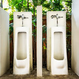 Restroom interior design with white urinal row Royalty Free Stock Images