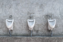 Restroom interior with urinal row Royalty Free Stock Photos