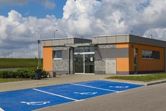 Restroom on rest station, autobahn in Poland, Europe. New modern resting place and parking in the parking lot of an autobahn at a summer day. Restroom on rest royalty free stock photos