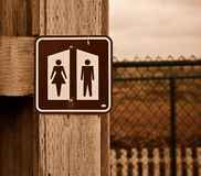 Restroom sign at a National Park. Female and male restroom sign at a National Park. An artifact which we may have become numb to, yet is hammered into our brains Royalty Free Stock Photos
