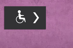 Restroom sign on pink wall Royalty Free Stock Photography