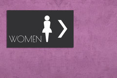 Restroom sign on pink wall Royalty Free Stock Image