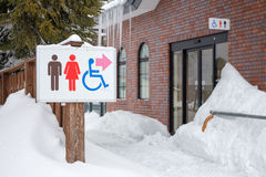 Restroom sign in the snow Royalty Free Stock Images