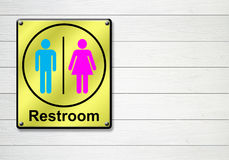 Restroom sign on white wooden wall background Stock Images