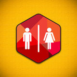 Restroom sign on yellow wall background Royalty Free Stock Image