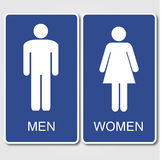 Restroom signs. Blue restroom signs on a gray background Stock Photo