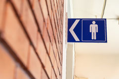 Restroom signs with male symbol and arrow direction Stock Images
