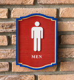 Restroom signs with male symbol. On birck wall Stock Photography