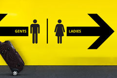 Restroom or Toilet Sign with Arrow and moving Luggage Royalty Free Stock Photography