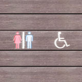 Restroom toilet sign on brown wood fence Royalty Free Stock Image