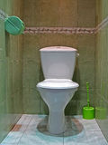 Restroom with white ceramics toilet,marble floor, Royalty Free Stock Photo