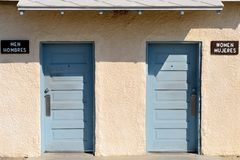 Restrooms with English and Spanish signs Stock Photography