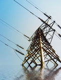 Result of global warmin. Simulation of flood waters around an electricity pylon Stock Photography
