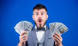 The result surpassed all his hopes. Bearded man holding cash money. Rich businessman with us dollars banknotes. Currency. Broker with bundle of money. Making stock photos