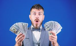 The result surpassed all his hopes. Bearded man holding cash money. Rich businessman with us dollars banknotes. Currency. Broker with bundle of money. Making royalty free stock photography