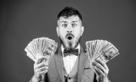 The result surpassed all his hopes. Bearded man holding cash money. Rich businessman with us dollars banknotes. Currency. Broker with bundle of money. Making royalty free stock photos