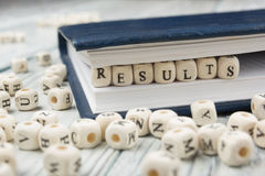 Result word background on wood blocks. Wooden ABC Royalty Free Stock Images