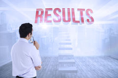 Results against city scene in a room Royalty Free Stock Image