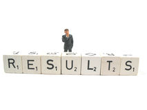 Results and business. Evaluating some results by businessman stock photos