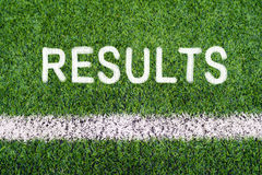 RESULTS hand writing text on soccer field grass Stock Image