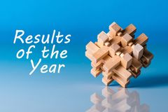 Results of the year - or 2017 Review. Text at blue background with brain teaser.  Stock Image