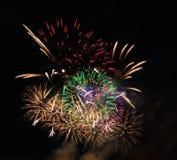 Resuma el fondo coloreado del fuego artificial usado por el Año Nuevo f de la capa Imágenes de archivo libres de regalías