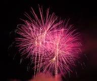 Resuma el fondo coloreado del fuego artificial usado por el Año Nuevo f de la capa Foto de archivo