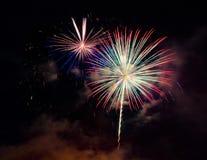 Resuma el fondo coloreado del fuego artificial usado por el Año Nuevo f de la capa Fotos de archivo libres de regalías