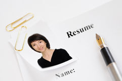 Resume. Form with a photograph and fountain pen Stock Photos