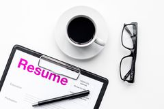 Resume of applicants near coffee, glasses on white background top view.  Royalty Free Stock Images