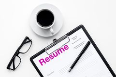 Resume of applicants near coffee, glasses on white background top view.  Stock Photography