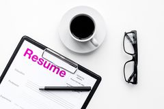 Resume of applicants near coffee, glasses on white background top view.  Stock Photo