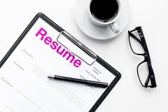 Resume of applicants near coffee, glasses on white background top view.  Stock Images