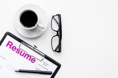 Resume of applicants near coffee, glasses on white background top view copy space. Resume of applicants near coffee, glasses on white background top view Stock Photo