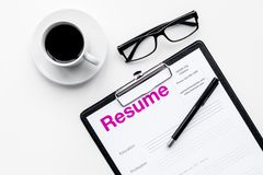 Resume of applicants near coffee, glasses on white background top view.  Stock Image