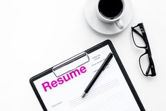 Resume of applicants near coffee, glasses on white background top view.  Royalty Free Stock Image