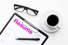 Resume of applicants near coffee, glasses on white background top view.  Royalty Free Stock Photos
