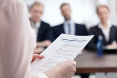 Resume for corporation job. Woman holding her resume for job in corporation Royalty Free Stock Image