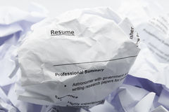 Resume crumpled up and thrown away in the trash Royalty Free Stock Photo
