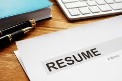 Resume on a desk. Recruiting and hiring. Looking for the job. Resume on the desk. Recruiting and hiring. Looking for the job royalty free stock image