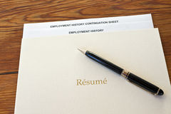 Resume folder with pen and employment history Royalty Free Stock Photography