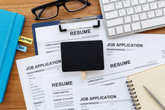 Resume and job application with blank sign Stock Photo