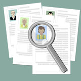 Resume with magnifier. Royalty Free Stock Photos