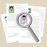 Resume with magnifier. Royalty Free Stock Image