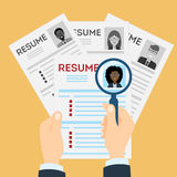 Resume with magnifier. Royalty Free Stock Images