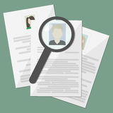 Resume search worker , ,  CV,  documents on the desktop Royalty Free Stock Images